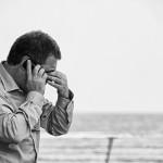 Worried man on the phone