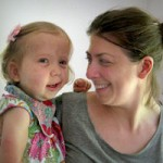A woman holding a little girl