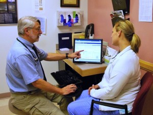 Peter Elias MD viewing medical record with patient